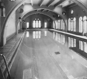 Historic photo of pool showing original placement of lanterns and reflection of skylights in pool.